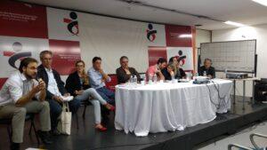 Mesa do evento teve lideranças da sociedade civil, imigrantes e autoridades. Crédito: Rodrigo Borges Delfim/MigraMundo