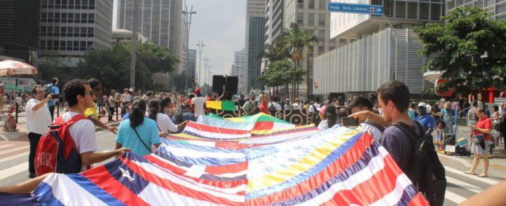 """Estamos aqui"": 11ª Marcha dos Imigrantes leva 4.000 à avenida Paulista"